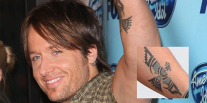 Greek tattoo, symbolic tattoo, Keith Urban on American Idol, phoenix perfume, Cool Celebrity Tattoos; Keith Urban's Phoenix Tattoo