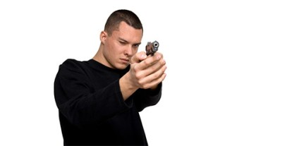 Playing criminal, black shirt and hand gun, white man criminal, shooting a gun, just like in the movies, action, badass man