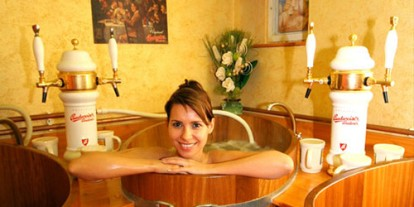 Beer bath, beautiful woman in a bucket, bathing in beer, beer overflow, Germany, Austria, Beer Therapy