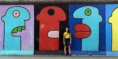 Colorful street Graffiti, art, street art, vandalism, cartoon faces, cool wall, woman in yellow shirt